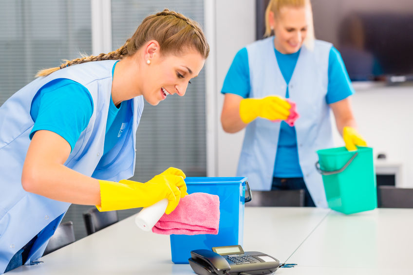 37778892 - commercial cleaning crew ladies working as team in office